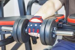 Man doing exercise with dumbbell for forearms Royalty Free Stock Images