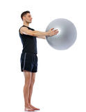 Man doing exercise with fit-ball Royalty Free Stock Image