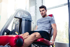 Man doing exercise on fitness machine Royalty Free Stock Images