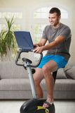 Man doing exercise at home Stock Image