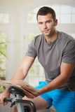 Man doing exercise at home Stock Images
