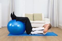 Man Doing Exercise With A Pilates Ball Royalty Free Stock Photo