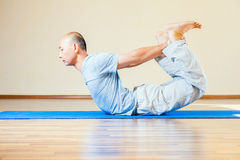 Man doing exercise of yoga indoor Royalty Free Stock Photos