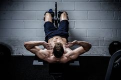 Man doing exercises for abdominal in The Gym's Studio Stock Photo
