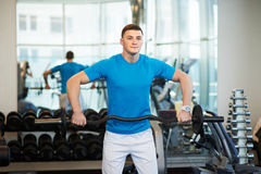 Man doing exercises with barbell Stock Photo