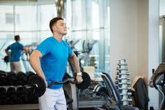 Man doing exercises with barbell Royalty Free Stock Images