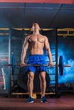 Man doing exercises with barbell Stock Photos