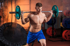 Man doing exercises with barbell stock images