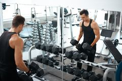 Man doing exercises dumbbell bicep muscles Royalty Free Stock Photo