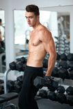 Man doing exercises dumbbell bicep muscles Stock Photo