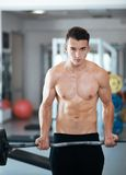 Man doing exercises dumbbell bicep muscles Royalty Free Stock Photography