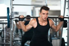 Man doing exercises dumbbell buttocks muscles Royalty Free Stock Images