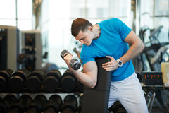 Man doing exercises dumbbells Royalty Free Stock Photography