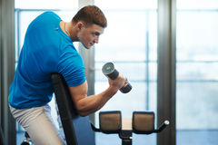 Man doing exercises dumbbells Stock Photos