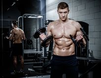 Man doing exercises with dumbbells in The Gym's Studio Stock Image