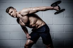 Man doing exercises with dumbbells in The Gym's Studio Stock Photography