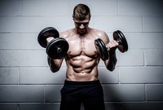Man doing exercises with dumbbells in The Gym's Studio Stock Photos