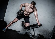Man doing exercises with dumbbells in The Gym's Studio Royalty Free Stock Photo
