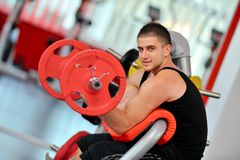 Man doing exercises in the gym Royalty Free Stock Images