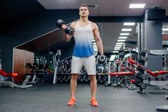 Man doing exercises in gym Stock Photos