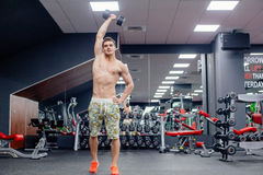 Man doing exercises in gym Stock Image