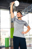 Man doing exercises with kettle ball at gym Stock Photo