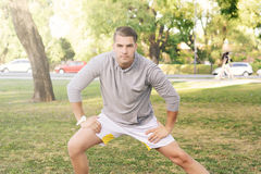 Man doing exercises at park. Royalty Free Stock Photography