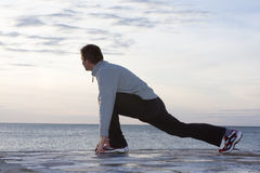Man doing exercises at the sea Royalty Free Stock Photo