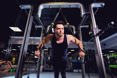 A man is doing exercises on  simulator in the gym Royalty Free Stock Image
