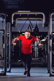 A man is doing exercises on  simulator in the gym Royalty Free Stock Images