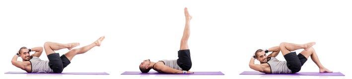 The man doing exercises on white Stock Photo