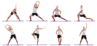 The man doing exercises on white Royalty Free Stock Image