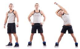 The man doing exercises on white Royalty Free Stock Photo