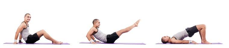 The man doing exercises on white Stock Photos