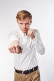 Man doing fighting stance Stock Photography