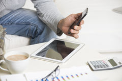 Man doing finance with tablet Stock Photos