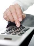 Man doing financial calculations Stock Photos
