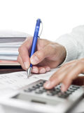 Man doing financial calculations Stock Photo