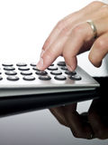 Man doing financial calculations Stock Images