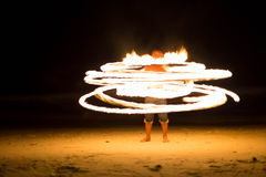 Man doing Fire show on beach party Stock Photography