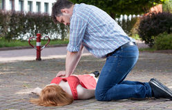 Man doing first aid royalty free stock images