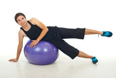 Man doing fitness exercise on ball Stock Images