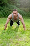 Man doing fitness exercise on the grass Royalty Free Stock Photo