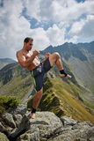Man doing fitness on a mountain Stock Image
