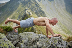 Man doing fitness on a mountain Stock Photo