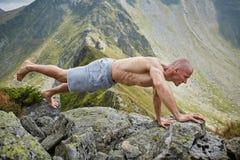 Man doing fitness on a mountain Stock Photo