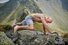 Man doing fitness on a mountain Royalty Free Stock Photos