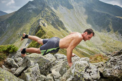 Man doing fitness on a mountain Stock Photography