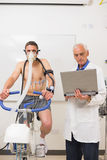 Man doing fitness test on exercise bike Royalty Free Stock Images