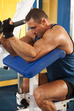 Man doing fitness training on a machine Royalty Free Stock Photography